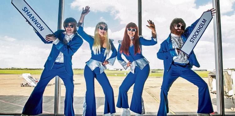 ABBA impersonators welcoming the launch of the new Scockholm to Shannon service