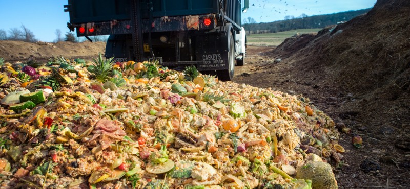 A truck dumps food waste