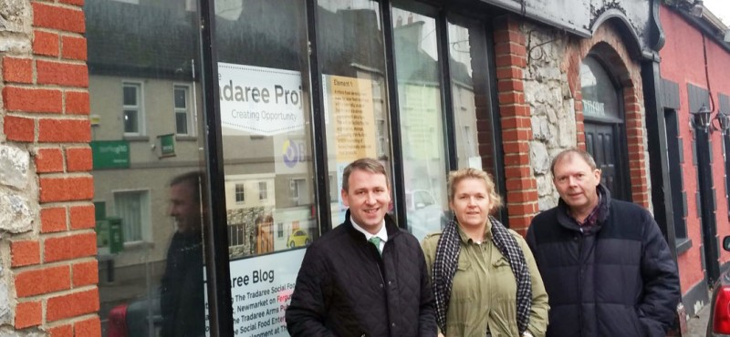 Deputy Joe Carey outside the Tradaree Arms with Siobhan O'Driscoll and former project manager Greg Brown.